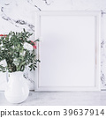 Blank frame and pink flowers over marble table 39637914