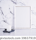 Blank frame and white candle over marble table 39637919