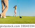 Female professional golfer hitting a long shot 39640394
