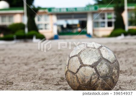 Old leather soccer ball in school asia  39654937