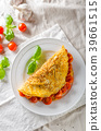 Rustic omelet with tomato 39661515
