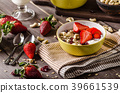 Oatmeal with yogurt, fresh strawberrie and nuts 39661539