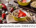 Oatmeal with yogurt, fresh strawberrie and nuts 39661552