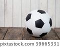 soccer ball isolated on wooden background. 39665331