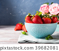 Strawberries in bowl with heart and roses 39682081
