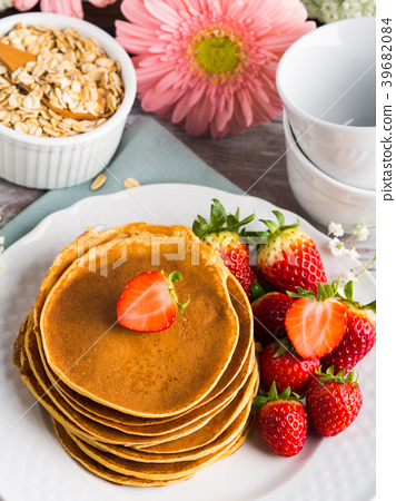 Stack of oatmeal pancakes with strawberries 39682084