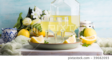 Home made limoncello in stemmed glasses 39682093