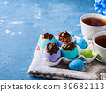 Easter background with cakes in eggs 39682113