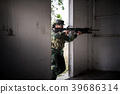 Special forces soldier holding gun aiming. 39686314