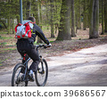 Young man riding on his bike In the park 39686567
