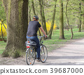 Young man riding on his bike In the park 39687000