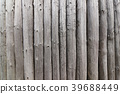 Wall from the wooden poles 39688449