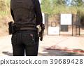 Woman carry gun in his waistband 39689428