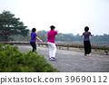 Asian senior elderly practice Taichi exercise  39690112