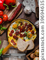 Omelette with chorizo and herbs 39694635