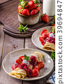 Pancakes with strawberries 39694847