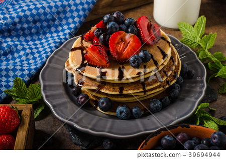American pancakes with berries and chocolate 39694944