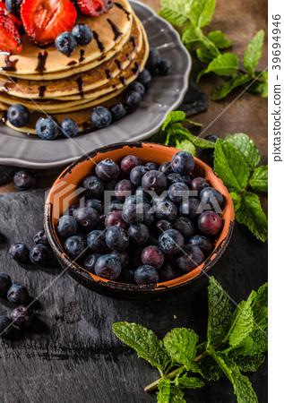 American pancakes with berries and chocolate 39694946