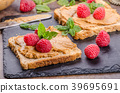 Toast with peanut butter and berries 39695691
