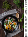 Fried eggs with ham and herbs 39696469