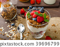Yogurt with baked granola and berries in small glass 39696799