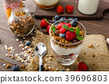 Yogurt with baked granola and berries in small glass 39696803