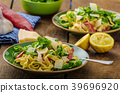 Tagliatelle with bacon, garlic and salad 39696920