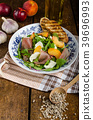 Rocket salad with prosciutto and fruit 39696993
