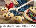 Blueberry muffins and pancakes 39697158