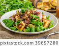Potato gnocchi with salad and onions 39697280