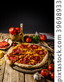 Rustic salami pizza with cheddar cheese and chorizo 39698933