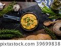 Scrambled eggs in a frying pan 39699838