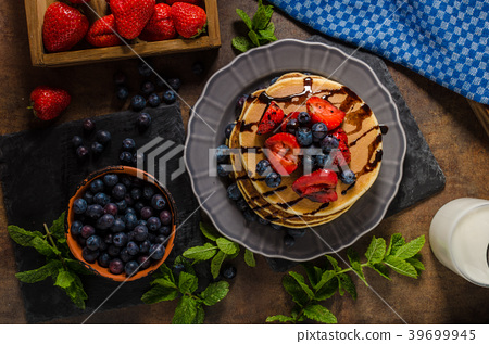 American pancakes with berries and chocolate 39699945