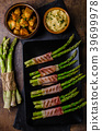 Asparagus on grill with bacon 39699978