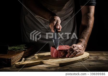 Chef butcher prepare beef steak 39699986