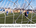 Soccer goal net against blurred background 39704204