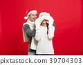 Christmas concept - Portrait of a romantic young 39704303