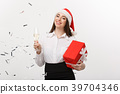 Christmas Concept - young business woman holding 39704346