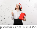 Christmas Concept - young business woman holding 39704355