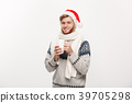 Christmas concept - Young beard man in sweater and 39705298