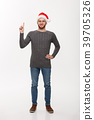 Holiday Concept - Young beard man in sweater enjoy 39705326