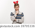 Holiday Concept - Young beard man in sweater with 39705336