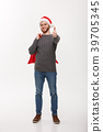 Christmas concept - Young confident smart man 39705345