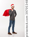 Christmas concept - Young confident smart man 39705348