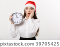 Time management concept - Young business woman 39705425