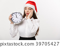 Time management concept - Young business woman 39705427