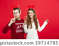Christmas concept - Happy young couple in sweaters 39714785