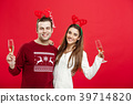 Christmas concept - Happy young couple in sweaters 39714820