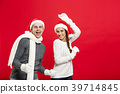 Christmas concept - Happy young couple in sweatesr 39714845