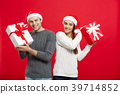 Christmas Concept - Young attractive couple giving 39714852